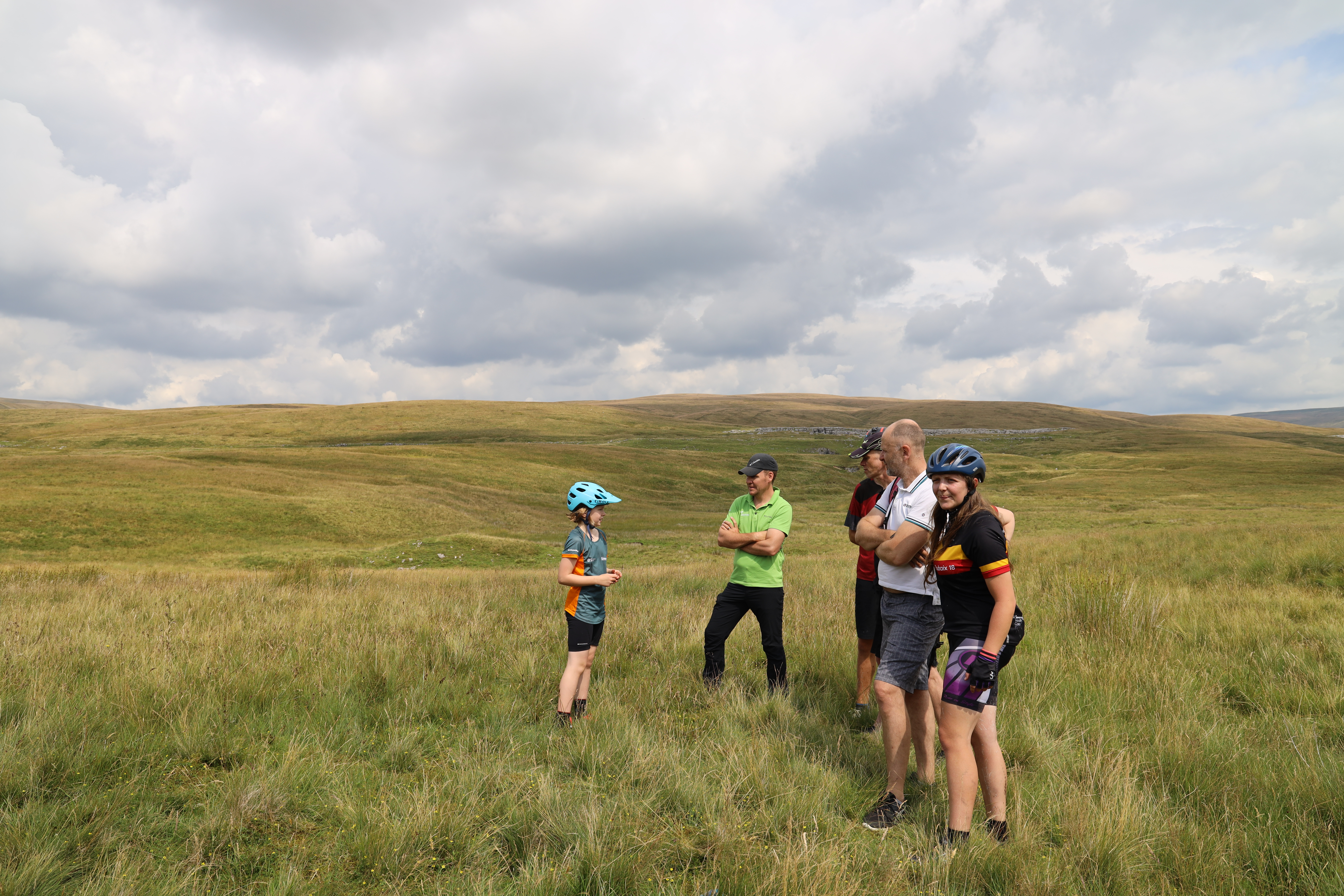 Cyclists and film crew atop a hill in the Dales, for Cycle the Dales promotional video with Pocket Projects