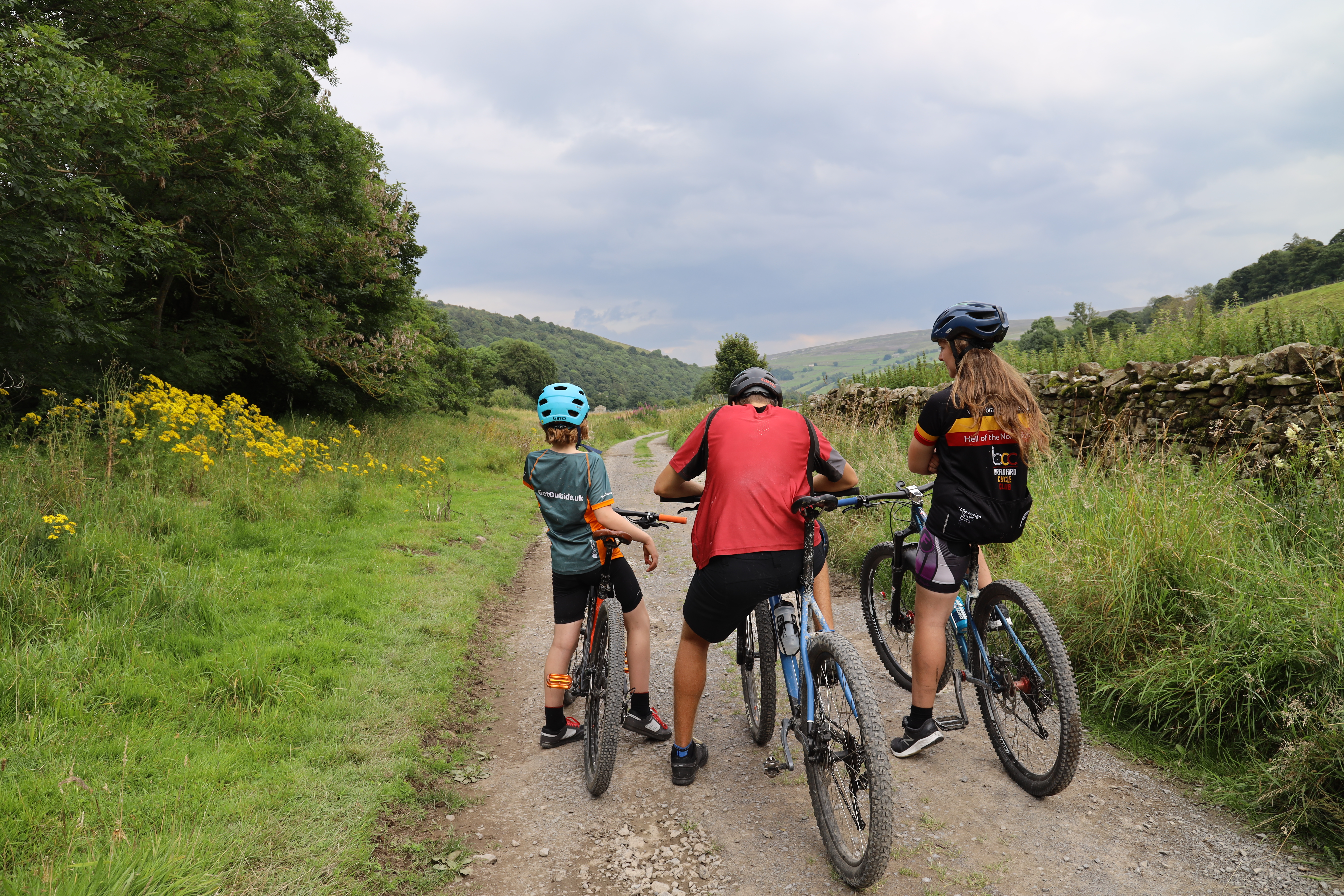 Three young mountain bikers rest on their bikes for Cycle the Dales promotional video production with Pocket Projects